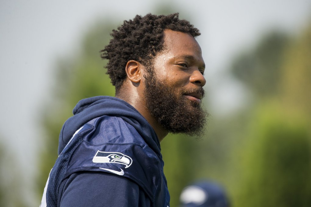 Seahawks defensive end Michael Bennett gives his two cents at Seattle Seahawks Training Camp.  (Bettina Hansen / The Seattle Times)