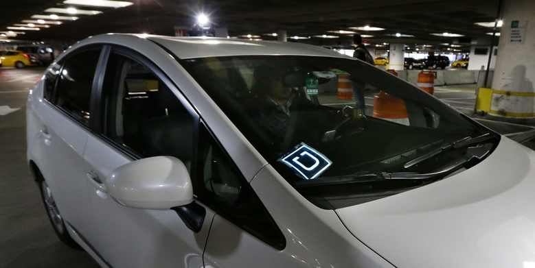 This March 2016 file photo shows an Uber driver arriving at Seattle-Tacoma International Airport in Seattle. (AP Photo/Ted S. Warren/File)  (Ted S. Warren/AP)