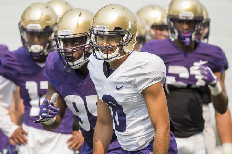Wide Receiver Dante Pettis Front And Defensive Lineman Levi Onwuzurike Line Up For Drills