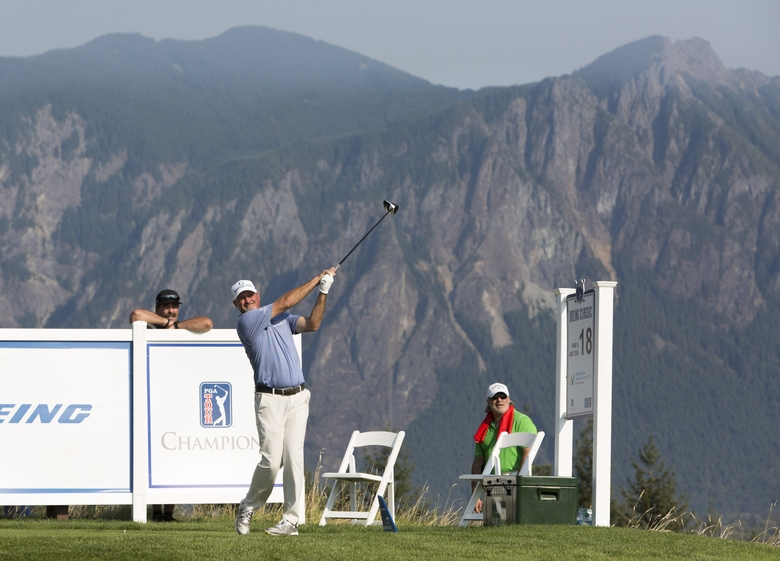 Mt. Si is pictured in the background as Jerry Kelly tees off on the 18th tee during the final round of the Boeing Classic golf tournament at The Club at Snoqualmie Ridge in Snoqualmie, Wash. on Sunday, Aug. 27, 2017. LOCATION – DESCRIPTION – 082717  (Jason Redmond/The Seattle Times)