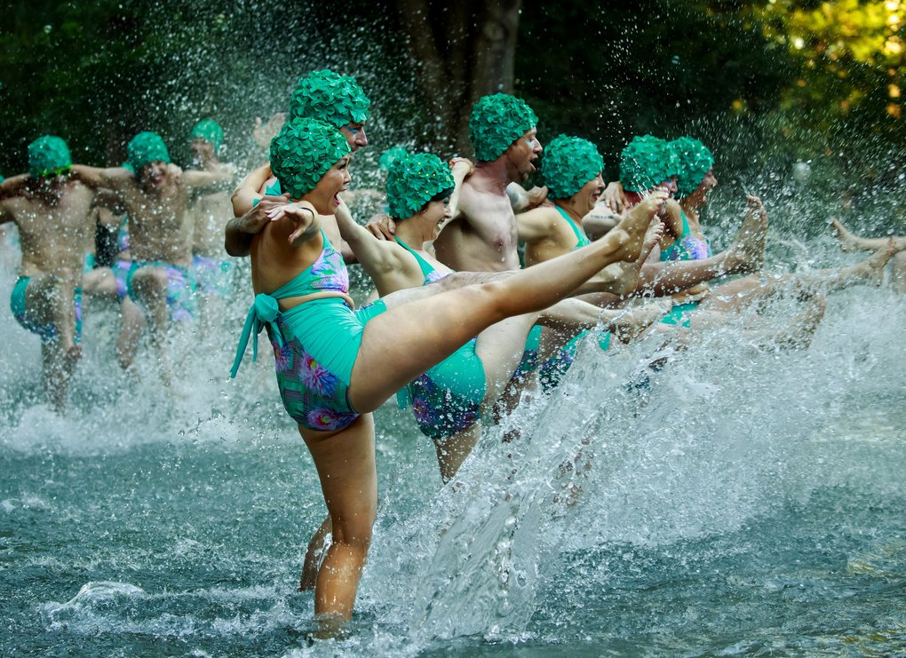 "Meishan Bettendorf, center front, performs with friends and fellow artists in ""Ankle Deep: A Water Ballet"" on July 24 at the Volunteer Park Wading Pool in Seattle. The performance was to honor artist Briar Bates, who cooked up the ballet scheme before her death.  (Erika Schultz/The Seattle Times)"