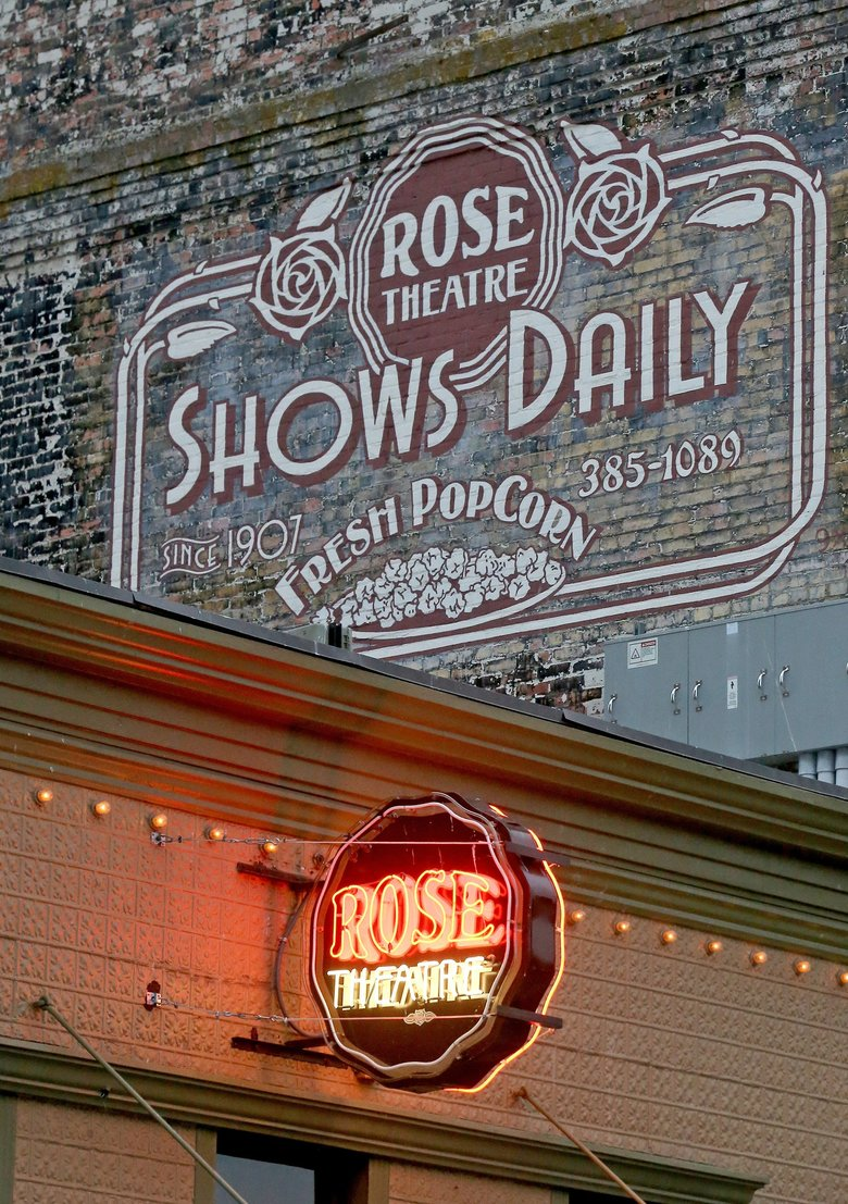 Vintage-style signs mark the theater's location on Taylor Street.  (Greg Gilbert/The Seattle Times)