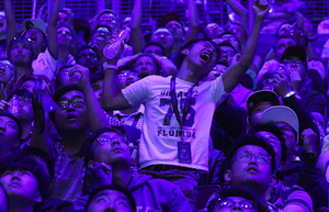A Team Liquid fan goes crazy with celebration as his team wins game two in a come-from-behind victory over Team Newbee at the DOTA 2 Grand Finals championships at Key Arena on Saturday August 12, 2017.  He's has many dejected Team Newbee fans around.