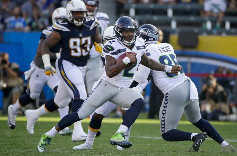 Trevone Boykin (2) had a big game for the Seahawks in the preseason opener, leading the team to four touchdowns and a field goal on the six drives he was in the game Sunday.  (Jae C. Hong/AP)