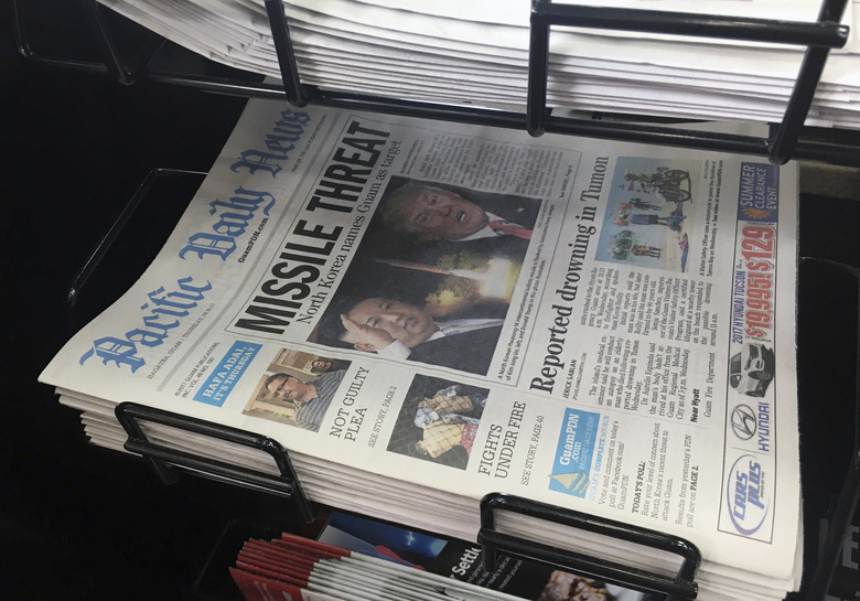 "A copy of the local newspaper is for sale in Hagatna, Guam on Thursday, Aug. 10, 2017. The small U.S. territory of Guam has become a focal point after North Korea's army threatened to use ballistic missiles to create an ""enveloping fire"" around the island. The exclamation came after President Donald Trump warned Pyongyang of ""fire and fury like the world has never seen."" (AP Photo/Tassanee Vejpongsa)"