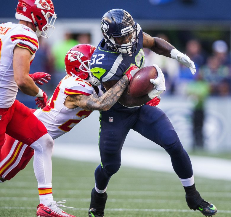 Chris Carson rumbles down the field for a 15-yard pickup to the Kansas City 26 in the 2nd quarter. The Kansas City Chiefs played the Seattle Seahawks in NFL preseason football Friday, August 25, 2017 at CenturyLink Field in Seattle. — 202395 (Dean Rutz/The Seattle Times)