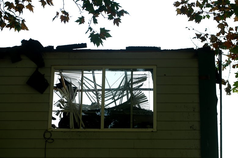 Another view of the burned apartment building  (Erika Schultz/The Seattle Times)