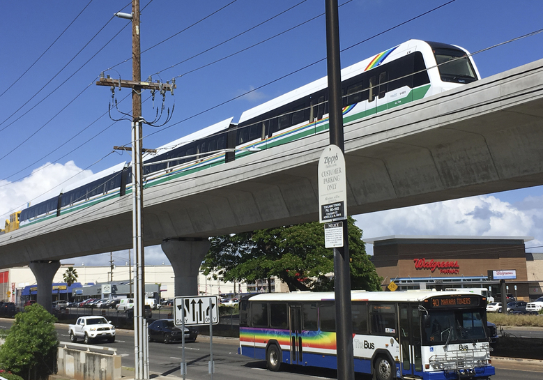 In this May 30, 2017 photo, a train sits atop a rail line under construction after a test-run in Waipahu, Hawaii. Honolulu's planned $9.5 billion rail transit project is one of the most expensive per capita in the nation. But it's facing a multi-billion dollar budget shortfall, and the future of the project is in jeopardy. Hawaii lawmakers are meeting this week to decide how to cover a budget shortfall as high as $3 billion. (AP Photo/Cathy Bussewitz)