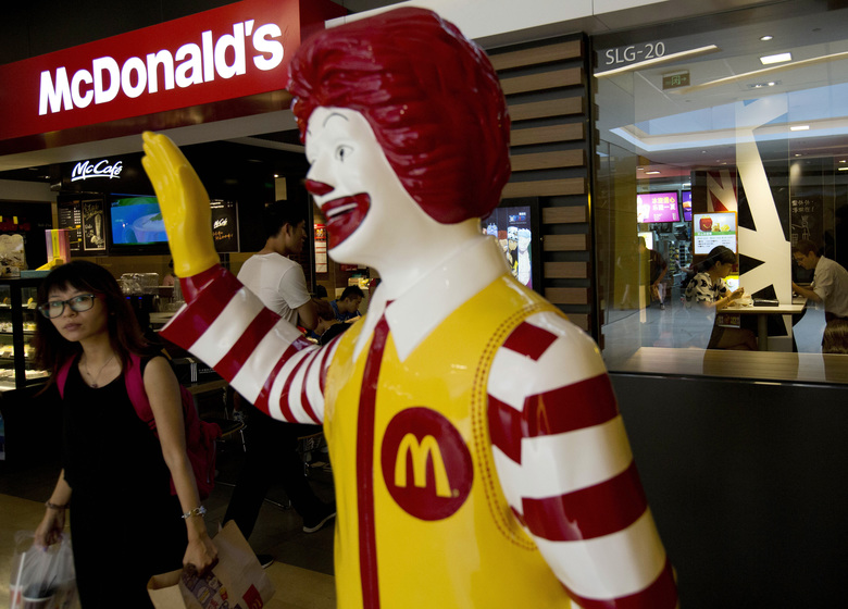 A statue of Ronald McDonald on display outside a McDonald's restaurant in Beijing. For the first time in more than 20 years, the Olympics are opening without the sponsorship of McDonald's. (AP Photo/Andy Wong, file)