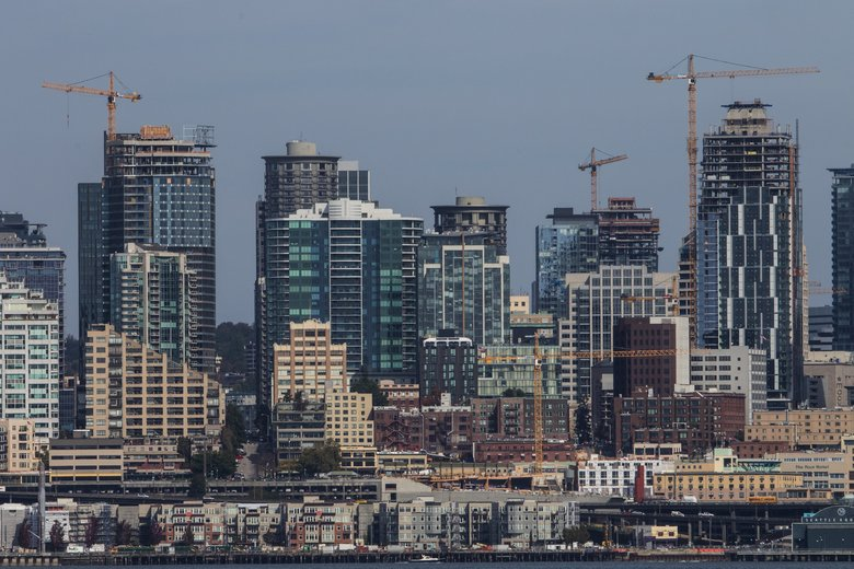 Cranes dot the downtown Seattle skyline. The construction boom has allowed the city to increase its budget by 40 percent between 2013 and 2017. (Ellen M. Banner / The Seattle Times, 2016)