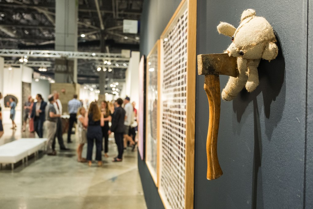 "Teddy meets an unpleasant demise in the work ""Axed"" by Russ Bonfanti, in the Rebecca Hossack gallery at the Seattle Art Fair. (Dean Rutz/The Seattle Times)"