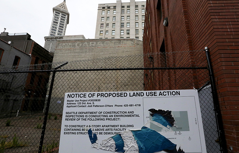 The proposed land use sign announces a six-story building with 80 units above an arts facility to be built. Seattle companies Spectrum and Laird Norton are announcing a $500 million plan to build new middle-class apartments. Their first project is the Canton Lofts at the corner Washington and Third in Pioneer Square.Gabe Grant, Hal Ferris, Jake McKinstry and Jeff Vincent.on Thursday May 8, 2017