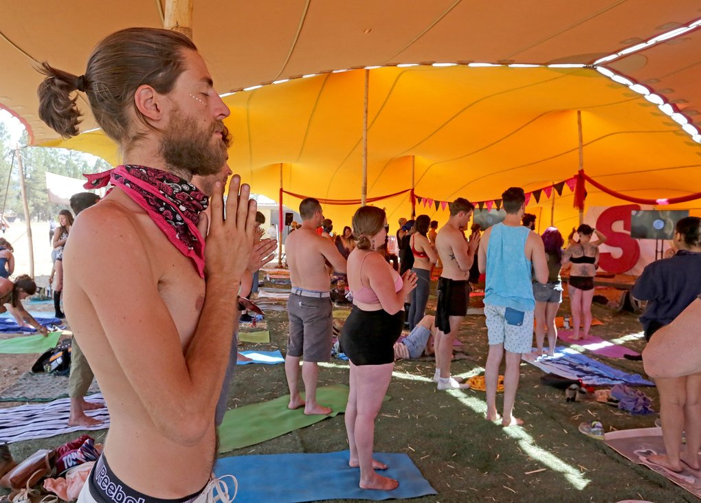 Festivalgoers meditate during a Sunday morning yoga class at the Oregon Eclipse Festival near Madras, which ends Aug. 23.  (Greg Gilbert/The Seattle Times)