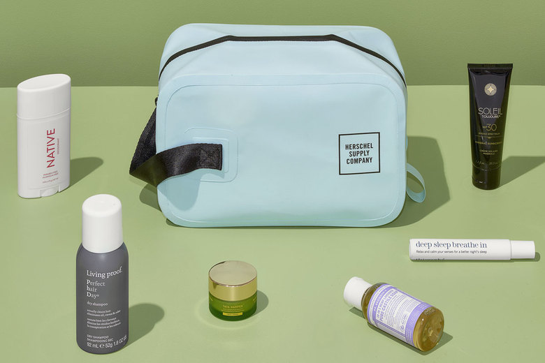 Herschel Studio Chapter Travel Kit, $50 at herschel.com, with (from left) Native Deodorant, $12; Living Proof Dry Shampoo, $12; Tata Harper Regenerating Cleanser, $42; Dr. Bronner's Pure-Castile Soap, $3.50; ThisWorks Stress Check Breathe, $30; Soleil Toujours 100% Mineral Sunscreen SPF 30, $25 (Photos by Corey Olsen / The New York Times)