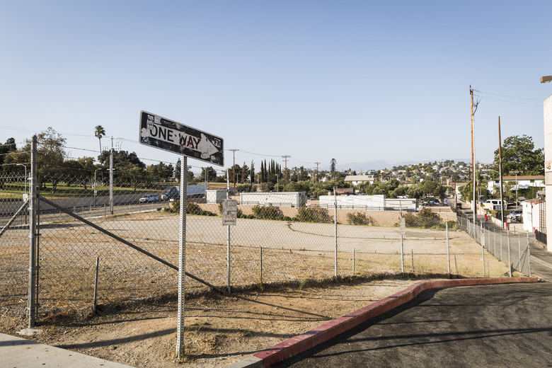 An empty lot in Los Angeles is a reminder that money isn't the only obstacle to solving homelessness. After strong opposition from the neighborhood, a City Council committee has blocked a homeless housing complex proposed for the site.  (EMILY BERL/NYT)