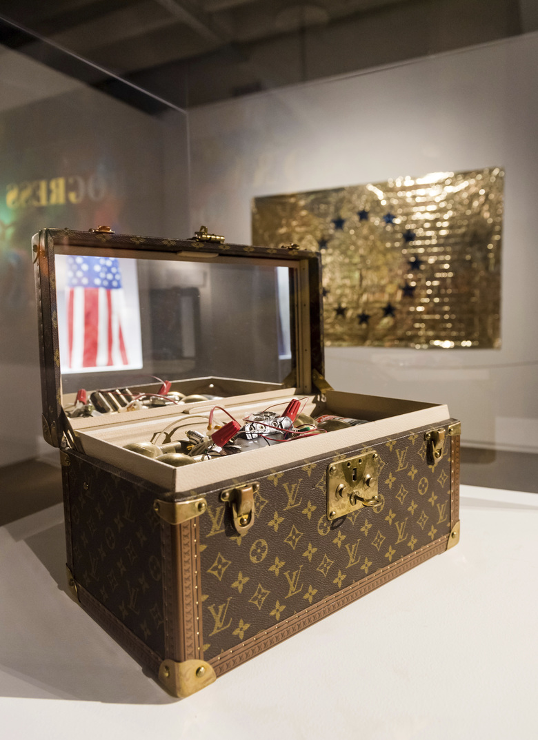 "An installation by U.S. artist Gregory Green in which a mock bomb is held in a Louis Vuitton vanity case for an exhibition ""Islam, It's Also Our History"" at the Espace Vanderborght in Brussels on Tuesday, Sept. 19, 2017. The show addresses difficult issues, including violent extremism. Funded by the European Union and Belgian authorities, the show was conceived many years before the deadly Paris attacks of 2015 were carried out by a Brussels-based extremist cell and the March 2016 attacks that killed 32 people in Brussels itself. (AP Photo/Geert Vanden Wijngaert)"