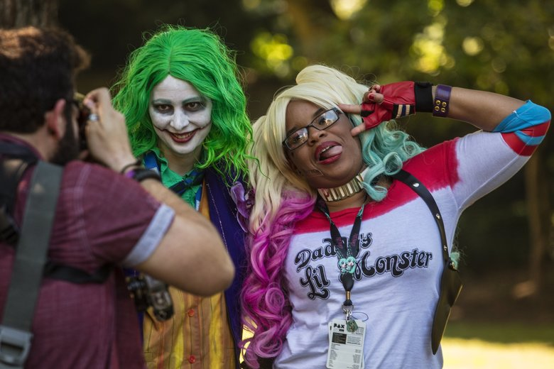 "Melanie Doyle as The Joker and Jasmine Butler, right, as Harley Quinn from the ""Suicide Squad"" movie pose for a photo outside the Washington State Convention Center, where they are attending PAX West.  (Steve Ringman / The Seattle Times)"