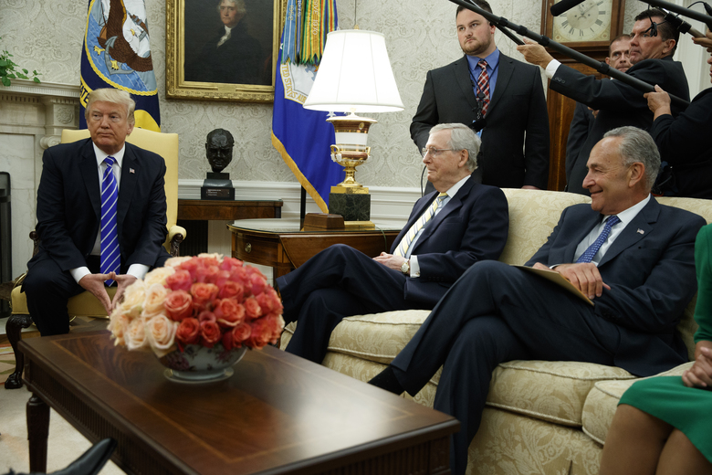 Senate Majority Leader Mitch McConnell, R-Ky., center, and Senate Minority Leader Chuck Schumer, D-N.Y., right, are shown with President Donald Trump, during a meeting with other Congressional leaders in the Oval Office of the White House, Wednesday, Sept. 6, 2017, in Washington. (AP Photo/Evan Vucci)