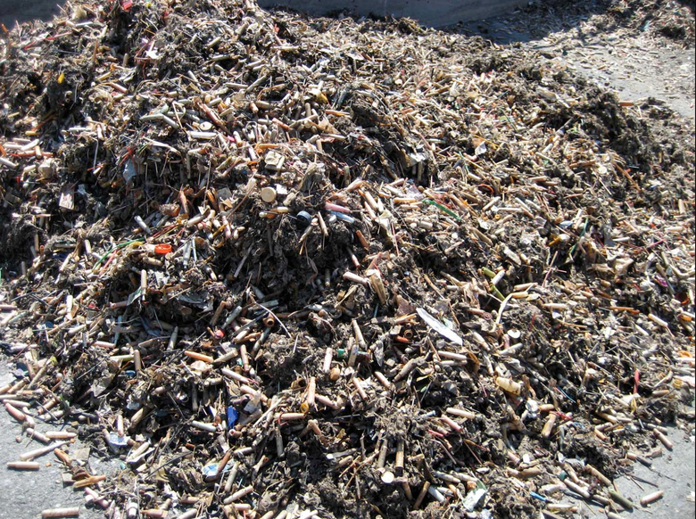 "About 200 retailers have agreed to offer compostable or recyclable options this month as part of an industry-led campaign, dubbed ""Strawless in Seattle,"" to prevent plastic from polluting ocean waters and threatening marine life. Here plastics are seen at a King County landfill. (King County)"