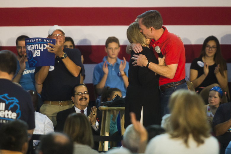 """Michigan Attorney General Bill Schuette hugs his wife, Cynthia Grebe, before announcing his gubernatorial campaign Tuesday, Sept. 12, 2017, at the Midland County Fairgrounds in Midland, Mich. Schuette launched a bid for governor Tuesday, entering as the Republican front-runner by promising to be a """"jobs governor"""" who will cut income taxes and high auto premiums and not accept that Michigan's best economic days are in the past. (Katy Kildee/Midland Daily News via AP)"""