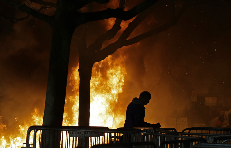 "FILE – In this Wednesday, Feb. 1, 2017, file photo, a bonfire set by demonstrators protesting a scheduled speaking appearance by Breitbart News editor Milo Yiannopoulos, burns on Sproul Plaza on the University of California at Berkeley campus on in Berkeley, Calif. Trump supporters and left-wing protesters have taken to the streets repeatedly in recent months in supposed free-speech demonstrations accompanied by escalating violence. But even on the so-called ""Left Coast,"" officials in famously liberal cities such as Portland and Berkeley are growing tired of the repeated violence. (AP Photo/Ben Margot, File)"