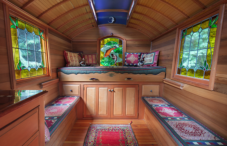 Wed. June 21, 2017.   NWLiving Caravan.    Denise Harris is a woodworker who over many years painstakingly crafted an incredibly authentic backyard caravan for guests based on one in England built in 1910. It's located behind her home on Bainbridge Island.