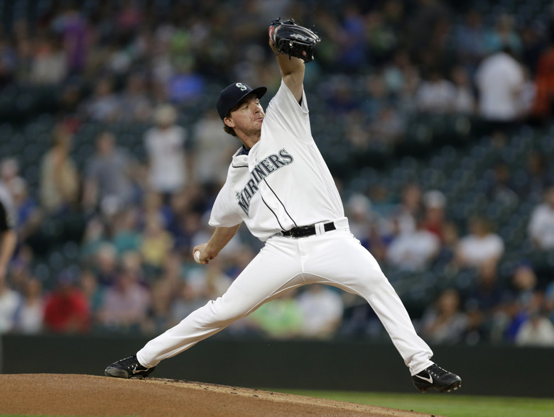 Mariners starting pitcher Andrew Moore works against the Houston Astros during the first inning. (John Froschauer/AP)
