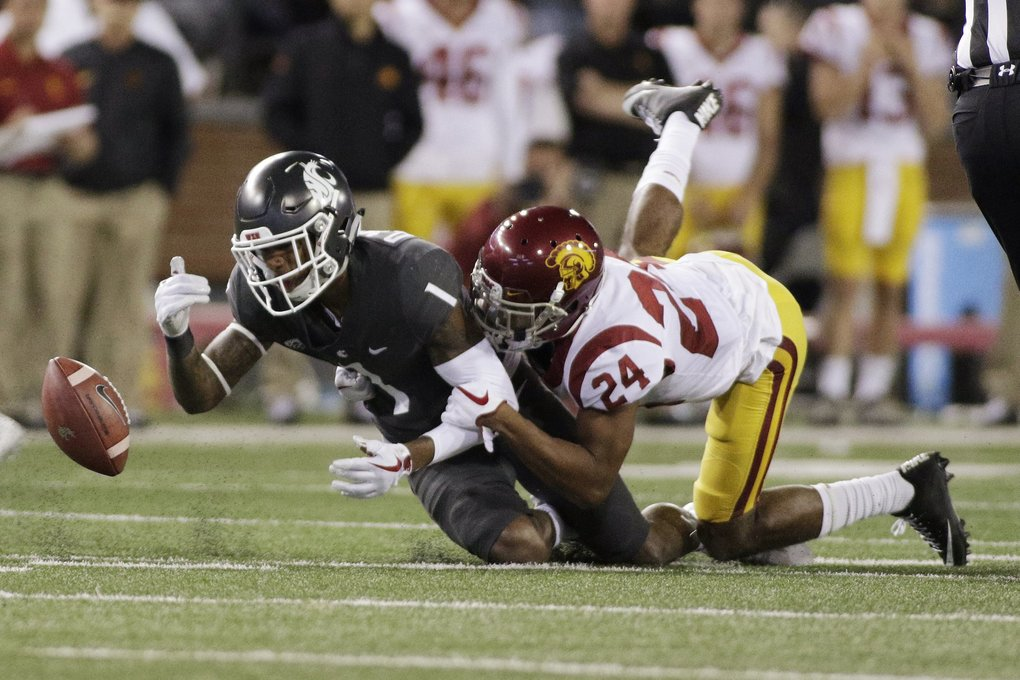 Washington State wide receiver Davontavean Martin (1) can't get to a pass as he is defended by Southern California cornerback Isaiah Langley (24) during the second half of an NCAA college football game in Pullman Friday. Washington State won 30-27. (Young Kwak / The Associated Press)