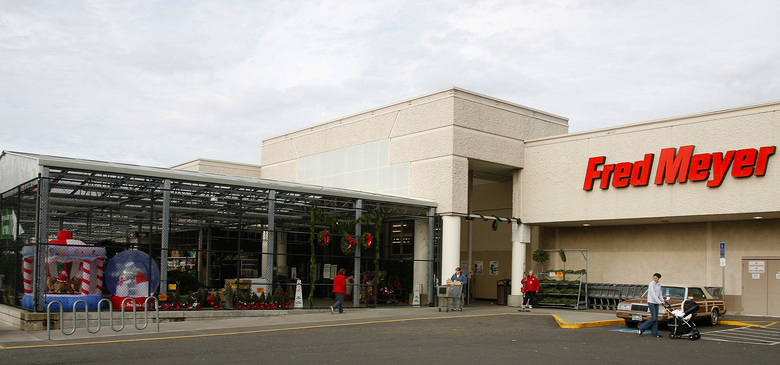 Investors see Kroger, owner of Fred Meyer and QFC, facing an uphill battle against Amazon, which recently acquired Whole Foods.  (TOM HAUCK/BLOOMBERG NEWS)