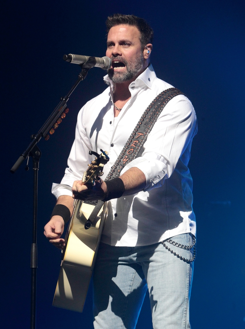 FILE – In this Jan. 17, 2013 file photo, Troy Gentry of the Country Music duo Montgomery Gentry performs on the Rebels On The Run Tour in Lancaster, Pa. Gentry, one half of the award-winning country music duo Montgomery Gentry, died Friday, Sept. 8, 2017, in a helicopter crash, according to a statement from the band's website. He was 50.  The group was supposed to perform Friday at the Flying W Airport & Resort in Medford, N.J. (Photo by Owen Sweeney/Invision/AP, File)