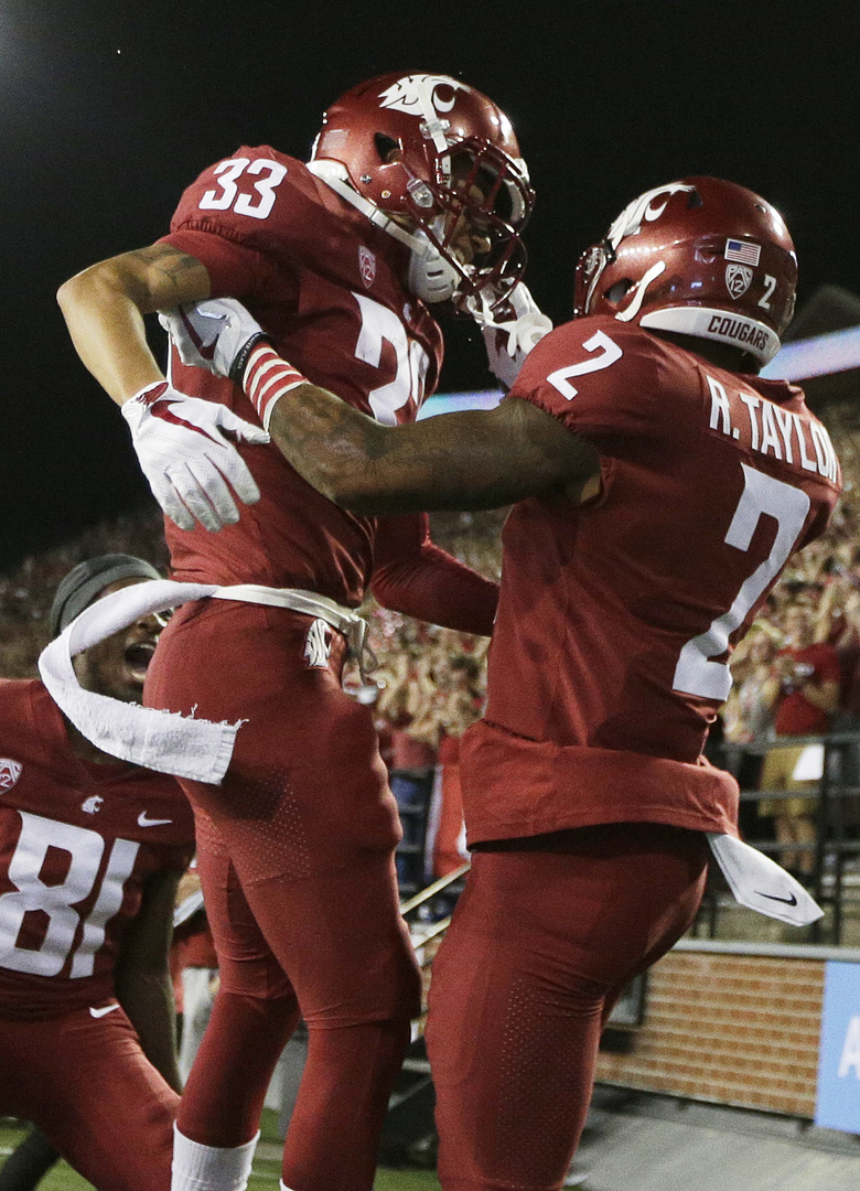 Washington State defensive back Robert Taylor (2) celebrates with teammate wide receiver Kainoa Wilson (33) after Taylor returned a fumble for a touchdown during the first half of an NCAA college football game in Pullman, Wash., Saturday, Sept. 9, 2017. (Young Kwak/AP)