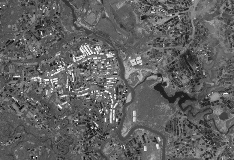This satellite photo provided by DigitalGlobe, take Sept. 16, 2017 show the thousands of temporary shelters that have been erected in the Kutupalong area of Cox's Bazar, Bangladesh. Before-and-after satellite images released to The Associated Press show refugee camps in Bangladesh growing dramatically since Rohingya Muslims began fleeing violence last month in their nearby homeland of Myanmar. (DigitalGlobe via AP)