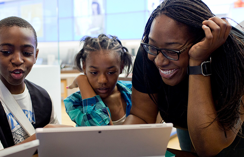 Shy Averett leads a workshop for a Hutchinson Elementary-Middle School class at the Microsoft store in Troy, Michigan in July. Averett, employed by Microsoft, tries to help people, especially children, while using the company's products. (Laura McDermott / The New York Times)