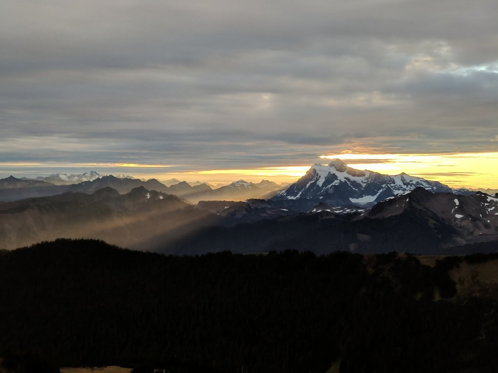 Photographer: Kalisa Beyer	 	 Photo taken: Skyline Divide Trail	on Sept. 24, 2017 	 Photographer's description: Backpacking near Mt. Baker, woke up to a beautiful sunrise. The rays of sunlight just starting to wake up the land. Used my phone, Google Pixel.