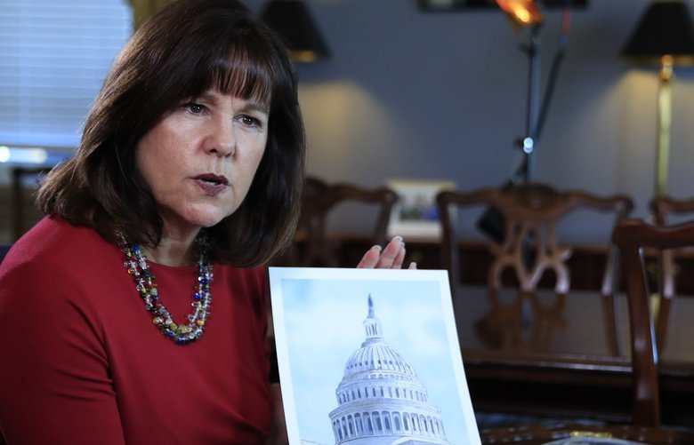 """Karen Pence, wife of Vice President Mike Pence, shows her artwork during an interview with The Associated Press in her office at the Eisenhower Executive Office Building on the White House complex in Washington, Tuesday, Oct. 17, 2017. Pence is using her platform as the vice president's wife to raise awareness about art therapy, a mental health field she's been passionate about for a decade but says is unknown to many. """"I don't think that a lot of people understand the difference between therapeutic art and art therapy,"""" Mrs. Pence, a trained watercolor artist, told The AP in an exclusive interview before she visits Florida on Wednesday to outline her vision for her art therapy initiative. (AP Photo/Manuel Balce Ceneta) WX204 WX204"""