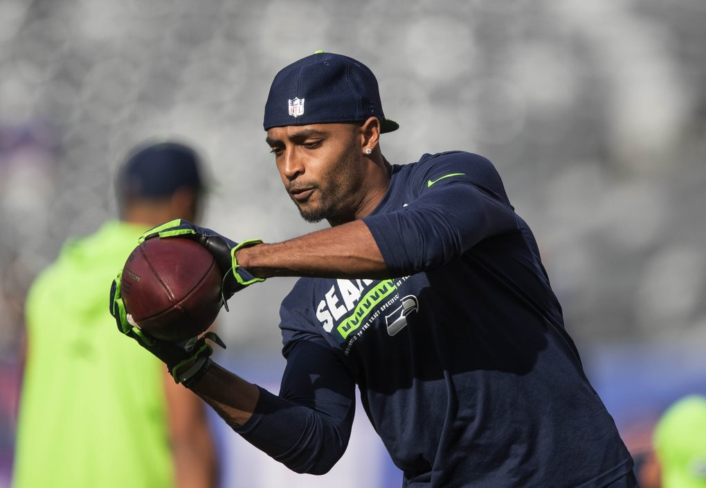 Doug Baldwin warms up for Sunday's game with the Giants. (Dean Rutz / The Seattle Times)