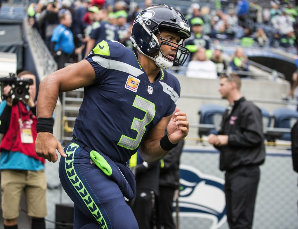 Russell Wilson takes the field for Sunday's game with the Texans at CenturyLink Field in Seattle. (Dean Rutz / The Seattle Times)