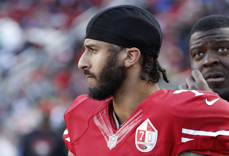 FILE – In this Jan. 1, 2017 file photo San Francisco 49ers quarterback Colin Kaepernick stands on the sideline during an NFL football game in Santa Clara, Calif. Wisconsin Gov. Scott Walker sent a letter Monday Oct. 16, 2017 to NFL Commissioner Roger Goodell and Players Association Executive Director DeMaurice Smith saying he believes players are showing disrespect for the flag and veterans. Former 49ers quarterback Colin Kaepernick started the protests last season when he refused to stand during the anthem to protest racial inequality and police brutality. (AP Photo/Tony Avelar File)