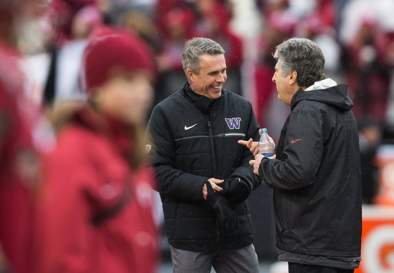 Washington head coach Chris Petersen and Washington State head coach Mike Leach.   (Lindsey Wasson / The Seattle Times)