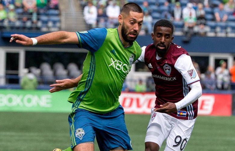 Seattle Sounders midfielder Clint Dempsey (2) takes the ball past Colorado Rapids midfielder Mohammed Saeid (90) during the first half at CenturyLink Field in Seattle on Sunday, Oct. 22, 2017. At the half Sounders lead 1-0.  203865