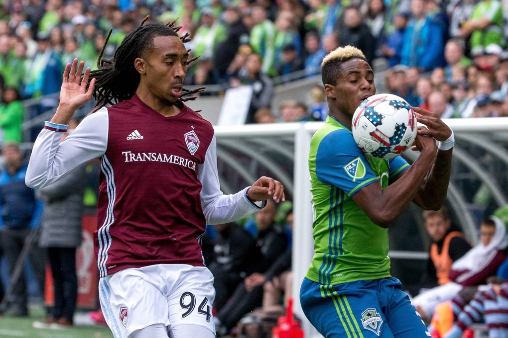 Seattle Sounders defender Joevin Jones (33) tries to gain control of the ball while Colorado Rapids midfielder Marlon Hairston (94) falls back for the call during the second half at CenturyLink Field in Seattle on Sunday, Oct. 22, 2017. Sounders beat the Rapids 3-0.  (Courtney Pedroza / The Seattle Times)