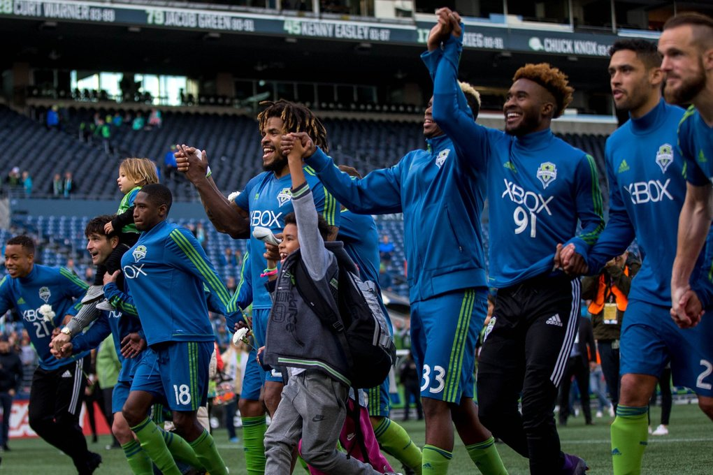 Seattle Sounders celebrate after a game against the Colorado Rapids at CenturyLink Field in Seattle on Sunday, Oct. 22, 2017. (Courtney Pedroza / The Seattle Times)