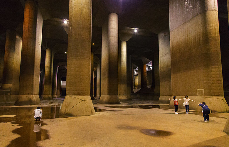 Visitors at the Metropolitan Area Outer Underground Discharge Channel, an underground anti-flood system in Kasukabe, Japan, Set. 19, 2017. Japan has spent billions on the underground system to control water around the capital, but some fear that the city is vulnerable as global warming brings more extreme weather. (Kentaro Takahashi/The New York Times)