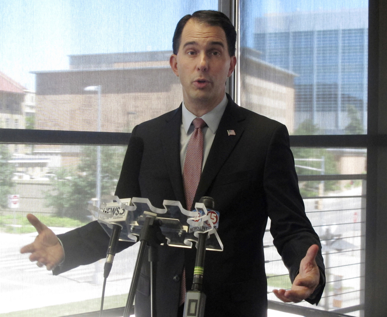 FILE – In this June 7, 2017 file photo, Wisconsin Gov. Scott Walker speaks to reporters during a news conference in Madison, Wis. The Republican former presidential hopeful sent a letter Monday Oct. 16, 2017 to NFL Commissioner Roger Goodell and Players Association Executive Director DeMaurice Smith saying he believes players are showing disrespect for the flag and veterans. Former San Francisco 49ers quarterback Colin Kaepernick started the protests last season when he refused to stand during the anthem to protest racial inequality and police brutality. (AP Photo/Scott Bauer File)