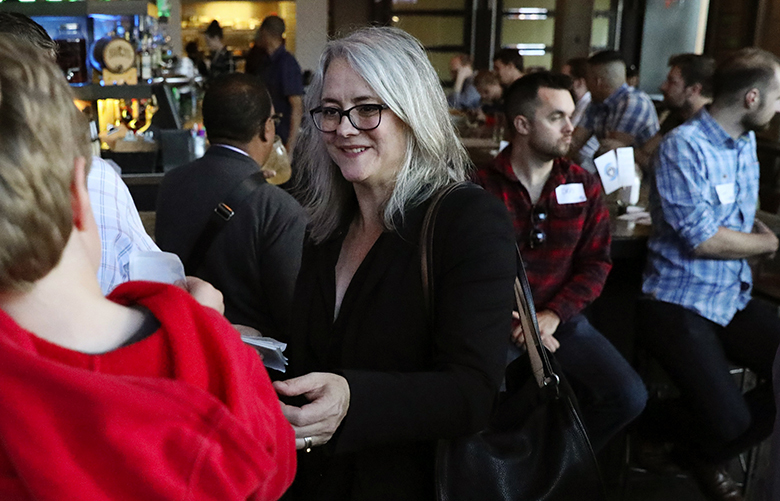 Seattle mayoral candidate Cary Moon greets supporters at a get-out-the-vote event with transit advocates at a Capitol Hill bar, Wednesday, Oct. 4, 2017, in Seattle.  203735