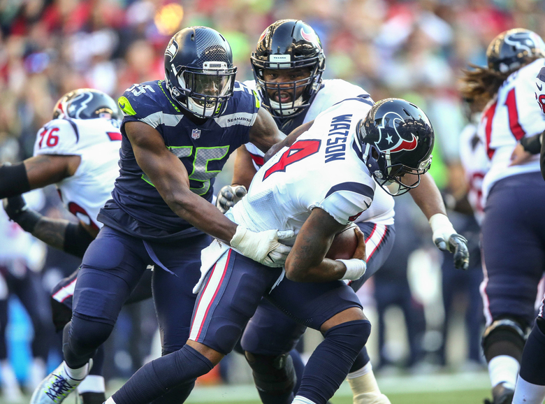 Seattle's Frank Clark (55) sacks Houston quarterback Deshaun Watson for a 10-yard loss with 16 seconds left, and Watson threw his third interception on the next play. Still, he led his team to 509 yards total offense. (Dean Rutz/The Seattle Times)
