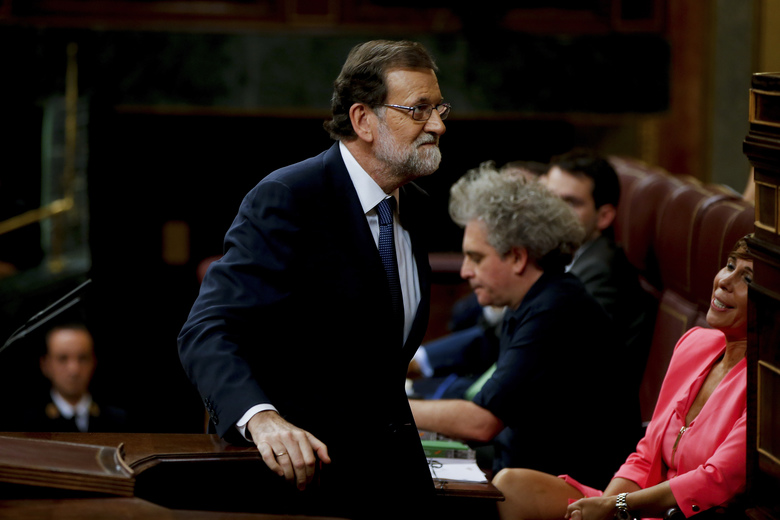 Prime Minister Mariano Rajoy steps up to speak at the Spanish parliament in Madrid, Spain, Wednesday, Oct. 11, 2017. Rajoy said he rejected offers of mediation in the Catalonia crisis, and called for respect of Spanish law while addressing Spain's parliament a day after Catalan officials signed what they called a declaration of independence from Spain. (AP Photo/Paul White)