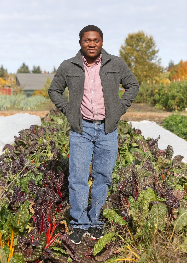 When Cornelius Adewale finishes his degree, he'll be returning home to Nigeria, which is grappling with climate-change issues that he hopes to address with an app and web tool. (Greg Gilbert/The Seattle Times)