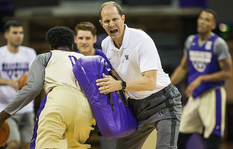 Husky coach Mike Hopkins puts defensive pressure on his team as they run through drills Tuesday.  Washington and its new men's coach, Mike Hopkins, met reporters Tuesday, October 17, 2017 for Media Day for the fall season.