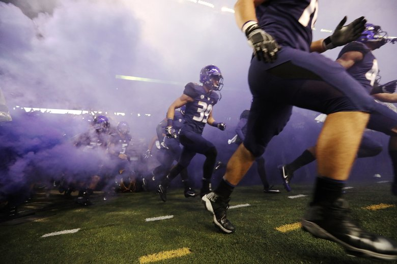 Players are introduced as the University of Washington takes on the University of California Golden Bears at Husky Stadium in Seattle Saturday. (Bettina Hansen / The Seattle Times)